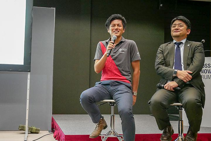 8_発表する井上の様子_Picture of Inoue at Cross Value Innovation Forum 2018.jpg