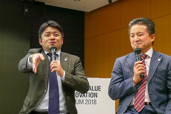 18_発表する光村氏と八子氏の様子_Picture of Mr.Komura and Mr.Yako at Cross Value Innovation Forum 2018.jpg
